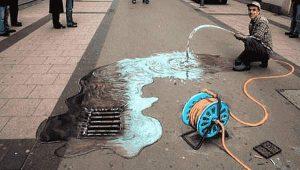 Pflastermalerei - Wasser läuft aus Schlauch